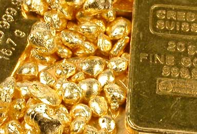 Goldbarren und Gold Nuggets